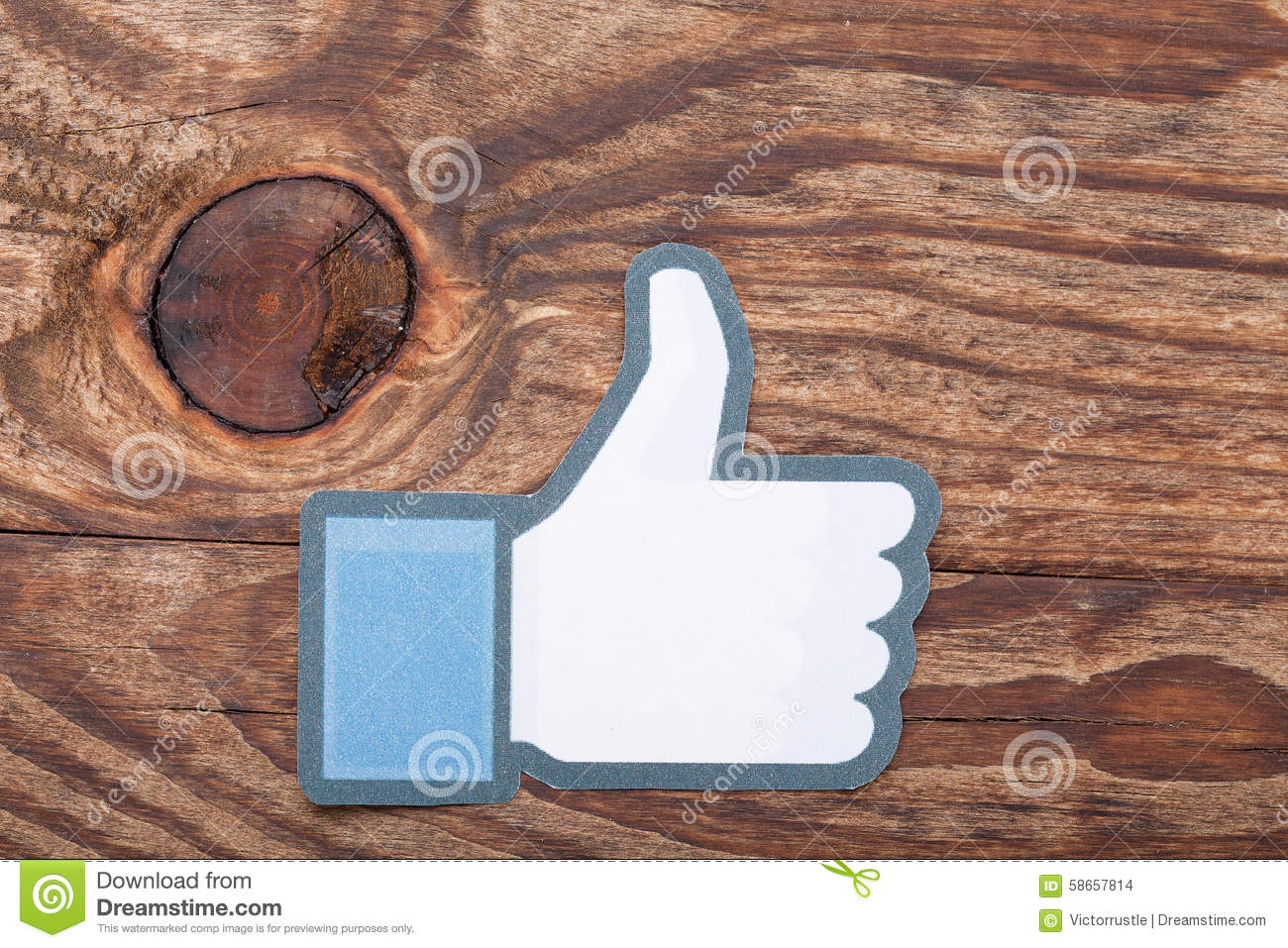 KIEV, UKRAINE - AUGUST 22, 2015: Facebook thumbs up sign printed paper. Is well-known social networking service.