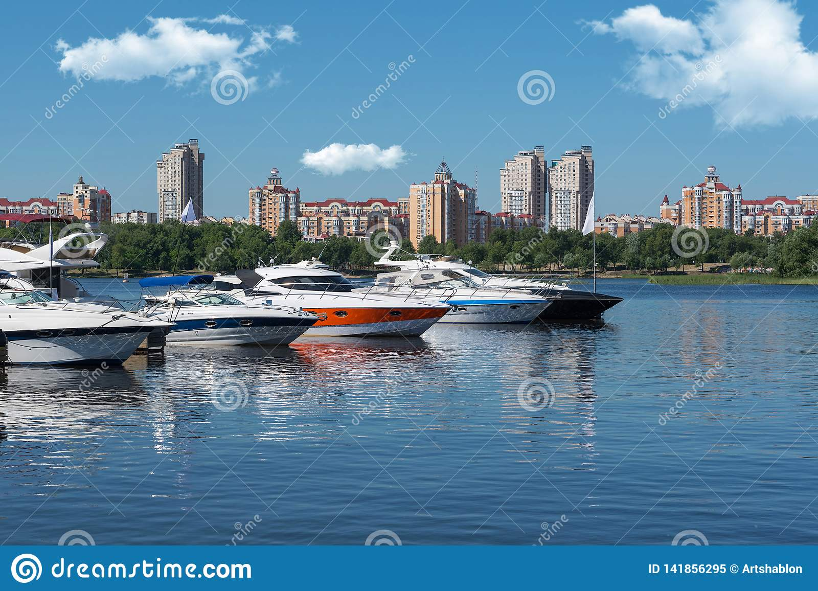 Kiev, Ukraine - June 01, 2018 : White yachts in the port, against the backdrop of the city. Yachts docked in river port