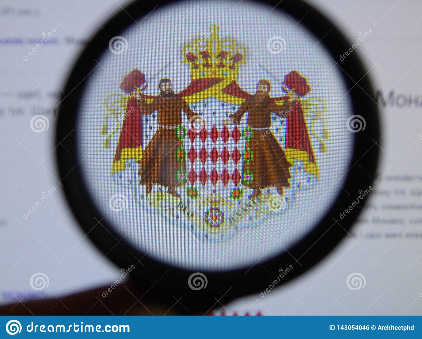 KIEV, UKRAINE - MARCH 23, 2019: Monaco coat of arms viewed through a magnifying glass