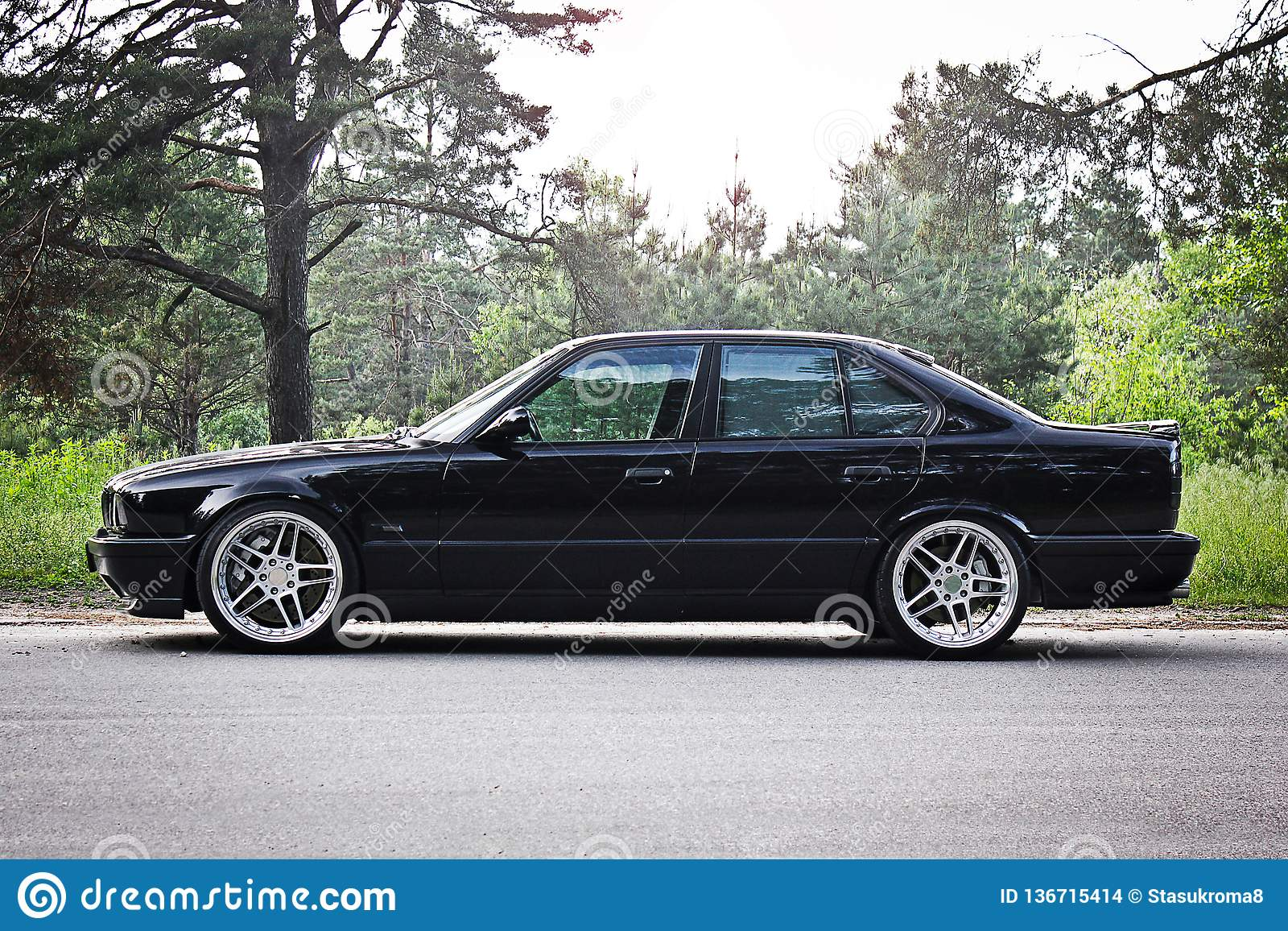 Kiev Ukraine May 17 2014 Bmw M5 E34 Against The Background Of The Forest Editorial Stock Image Image Of Bentley Chrome 136715414