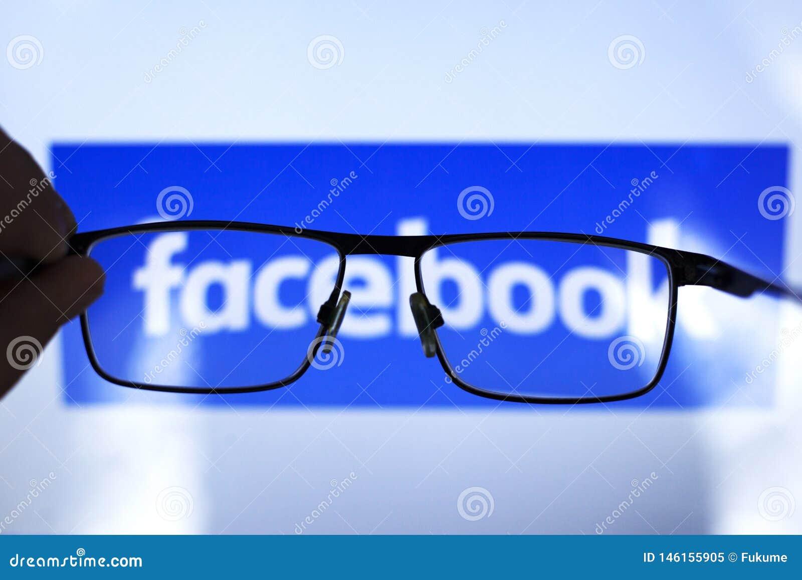 Kiev  Ukraine 04.26.2019 :  social network facebook through transparent glasses.ediitorial
