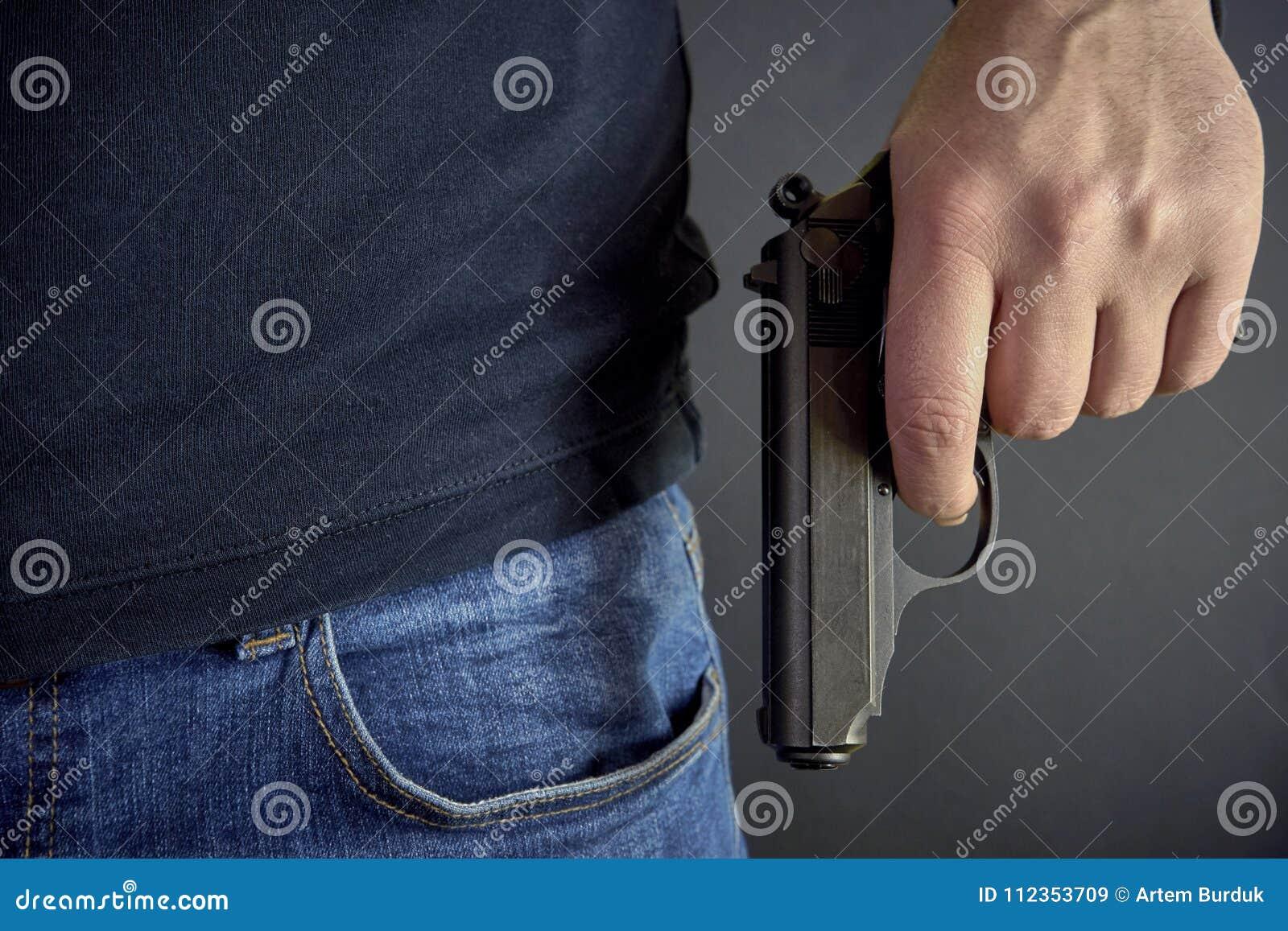 Killer holding a gun side him, robbery, murder, crime