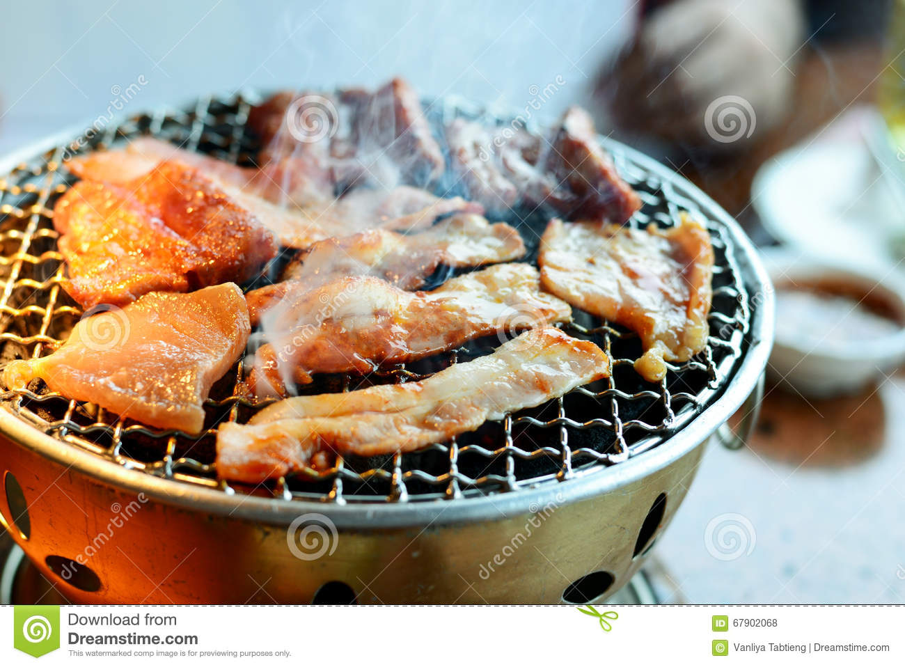 This kind of food is a Korean BBQ; Beef and Pork grill on hot co