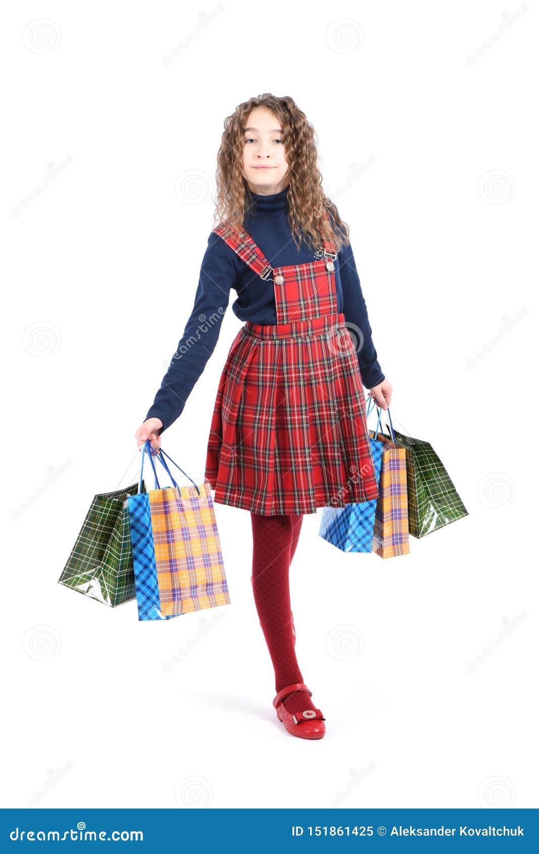 Kind mit einer verpackenden karierten Beschaffenheit lokalisiert auf weißem Hintergrund M?dchen mag im Verkauf kaufen Jahreszeit