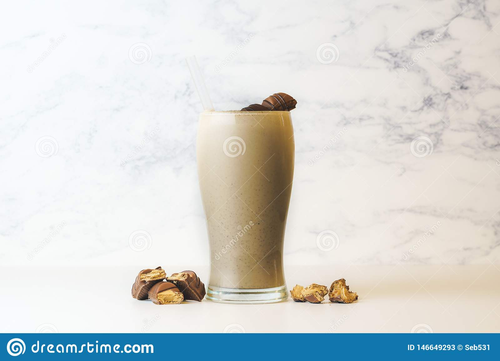 Kinder Bueno Milkshake in tall transparent glass. with copy space