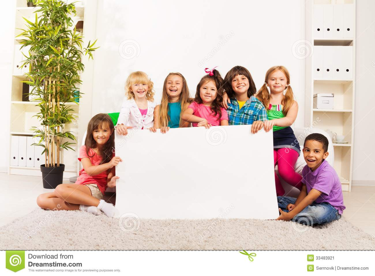 ... little kids sitting in the living room with blank advertising banner