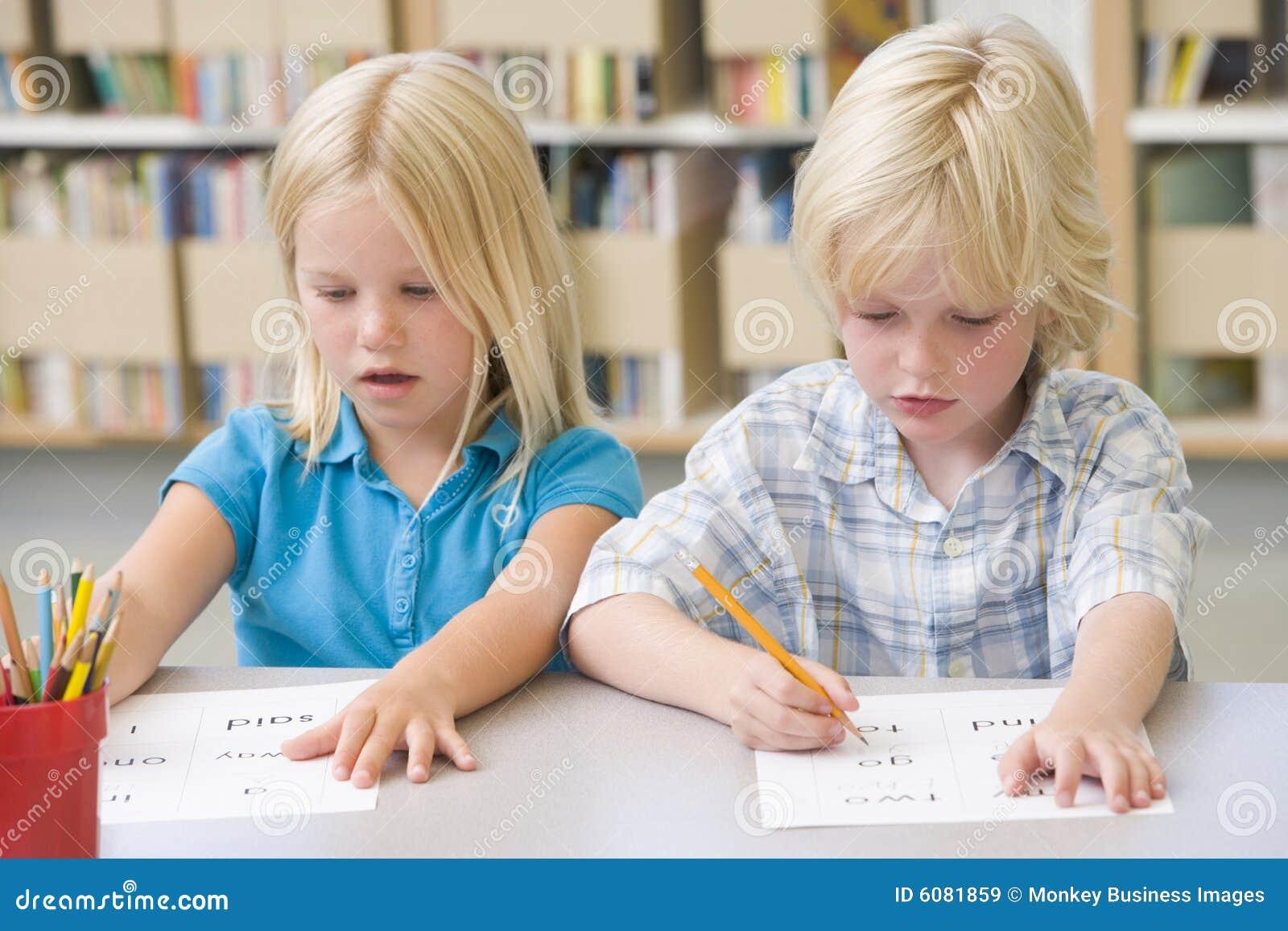 Kindergarten Children Learning To Write Stock Image ...