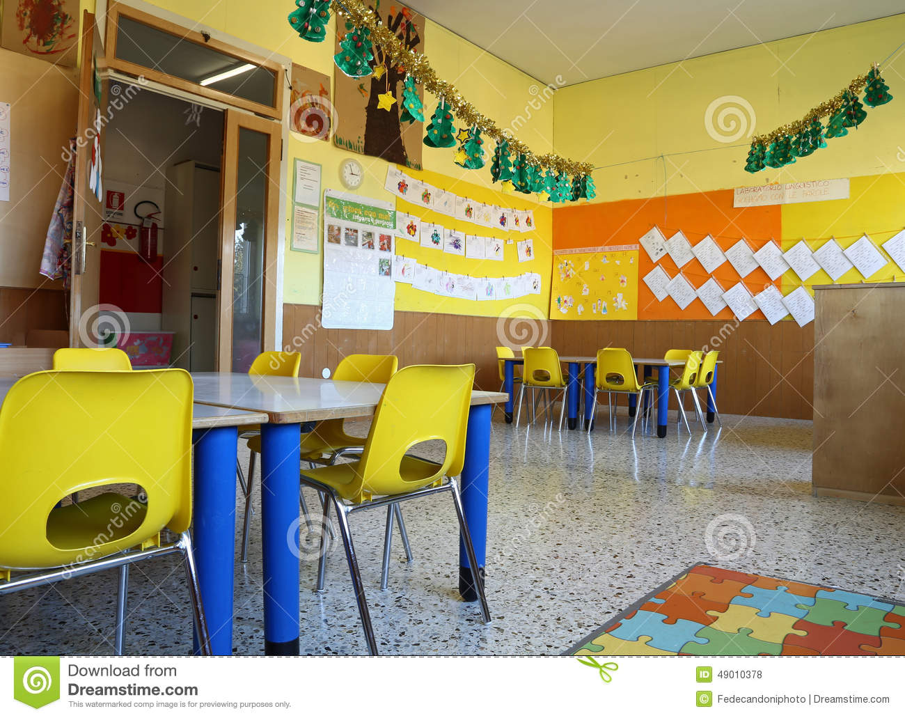 Kindergarten Classroom With Chairs And Table With Drawings