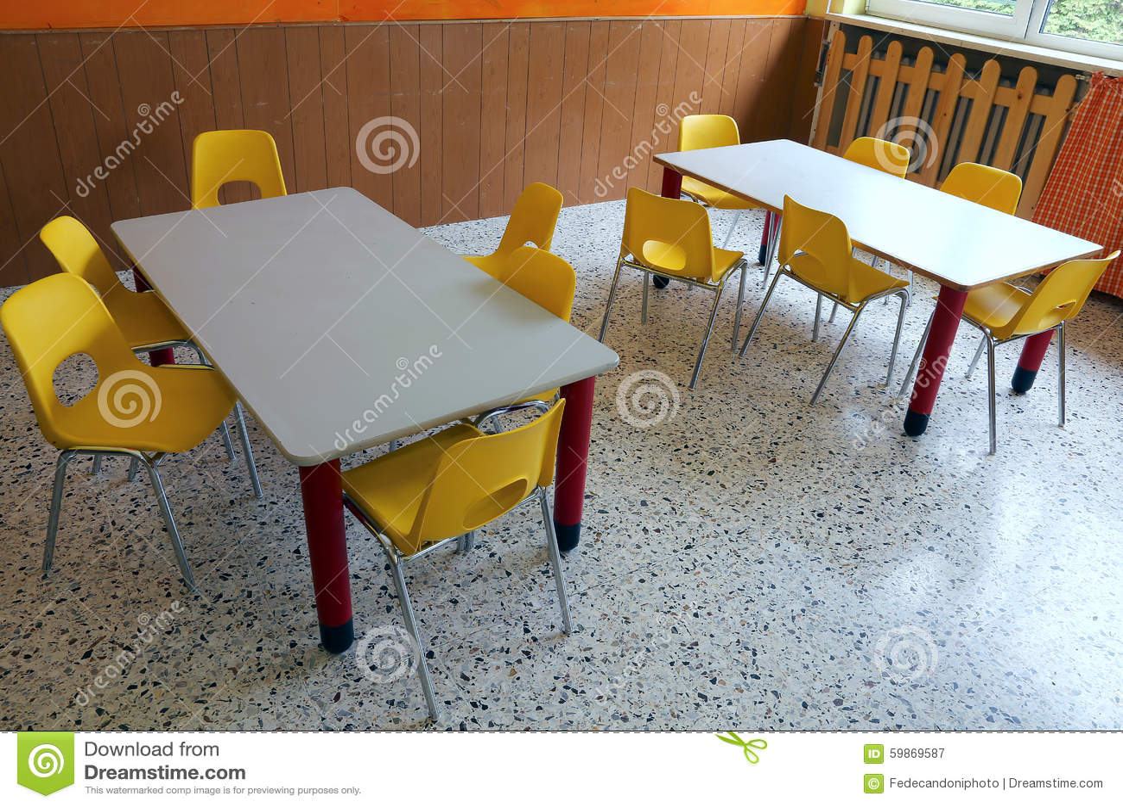 Kindergarten classroom table - Kindergarten Classroom With Desks And Yellow Chairs Stock Photo