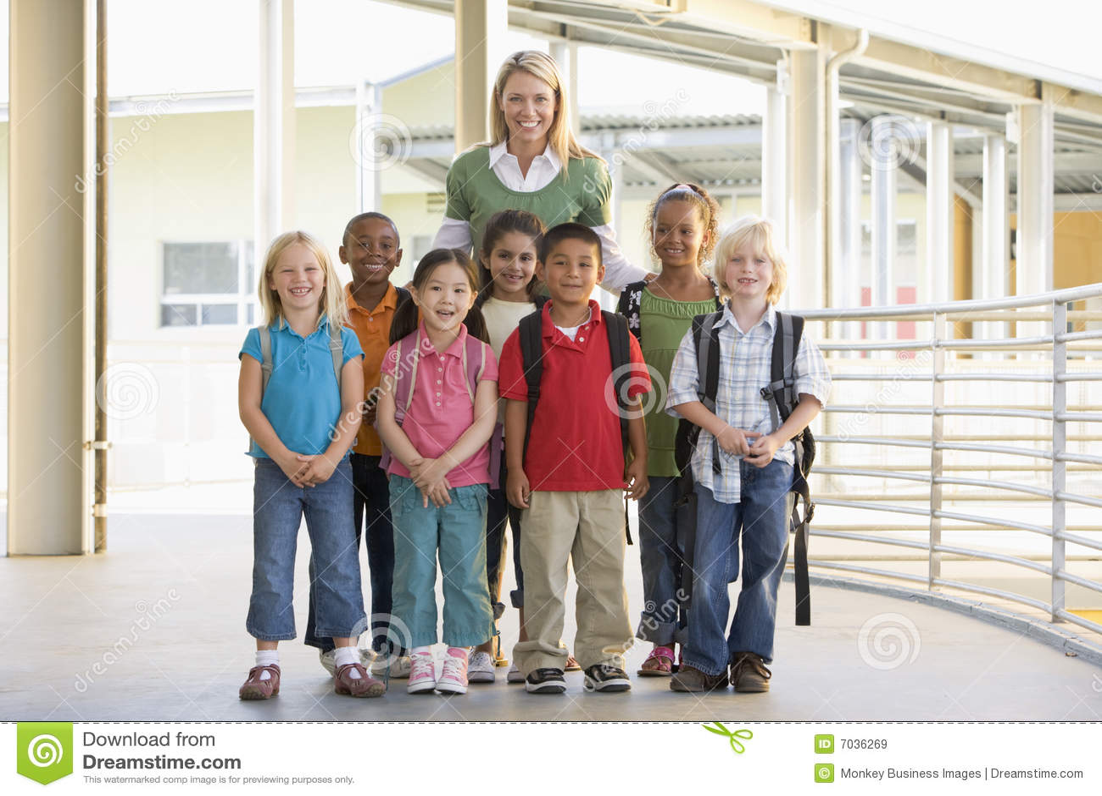 Kindergarten teacher standing with children