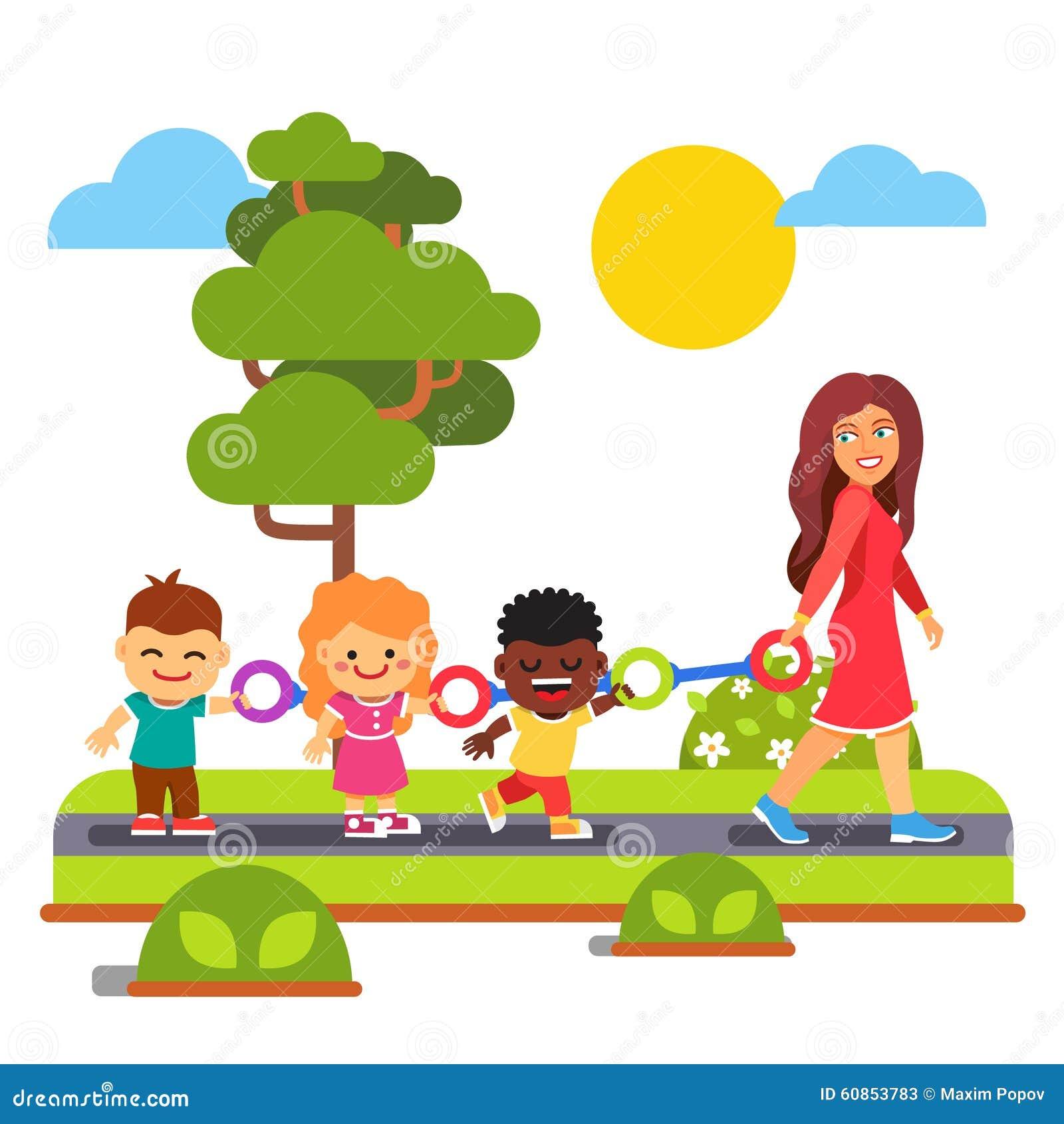 Kindergarten Teacher Walking With Kids Outdoors Stock