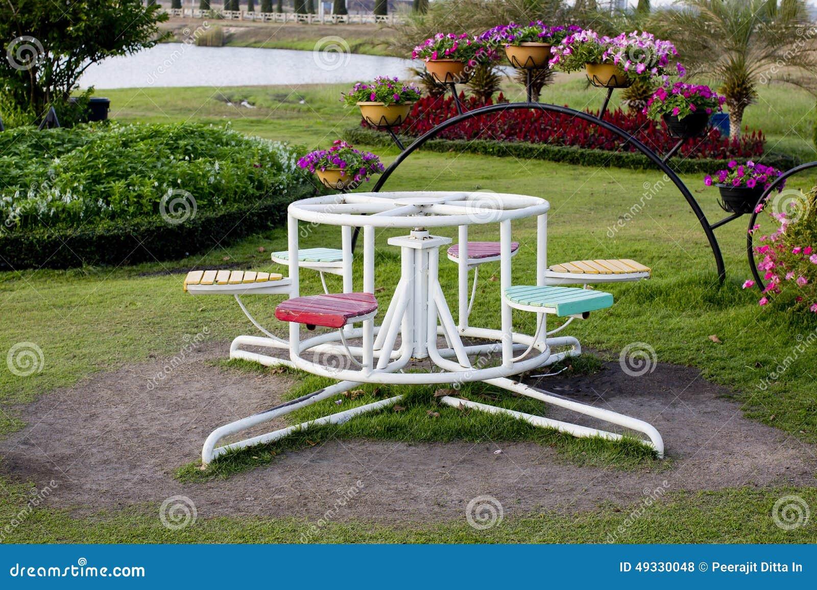 kinderkarussell im spielplatz stockfoto bild 49330048. Black Bedroom Furniture Sets. Home Design Ideas