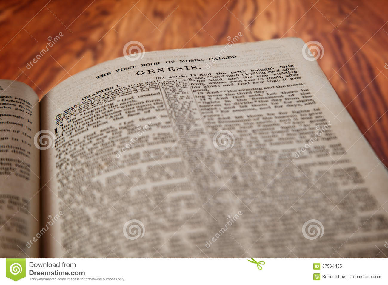King James Bible Book Of Genesis On Rustic Wooden Background