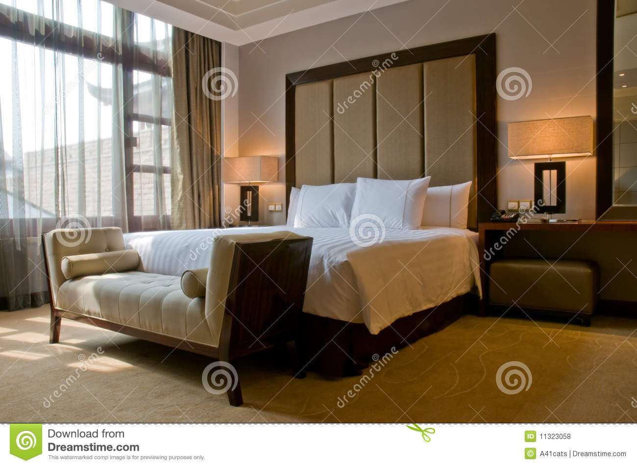 Modern vintage bedroom - King Size Bed In A Five Star Hotel Suite Room Royalty Free