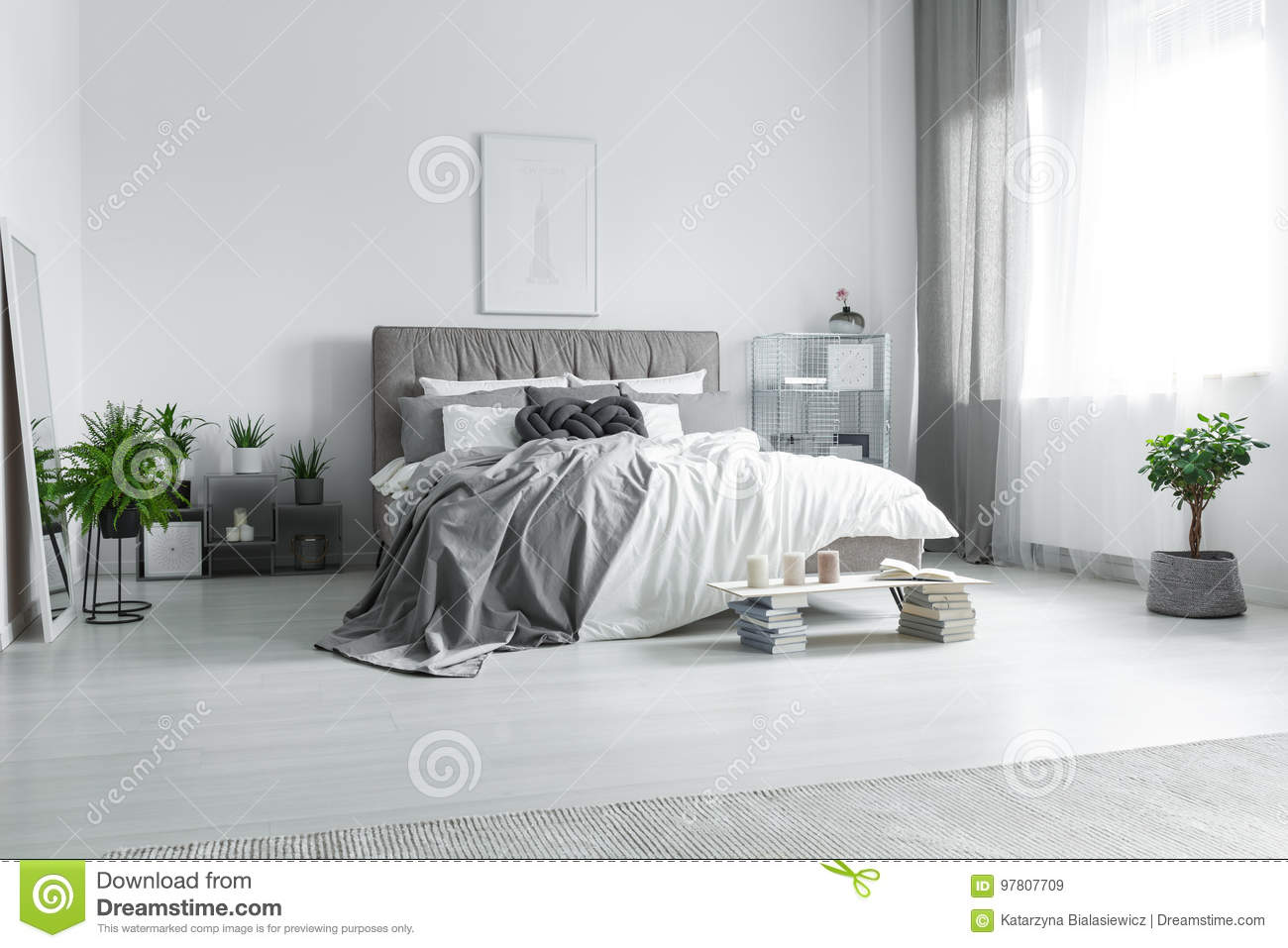 Messy bed in hotel room stock image. Image of candles - 97807709
