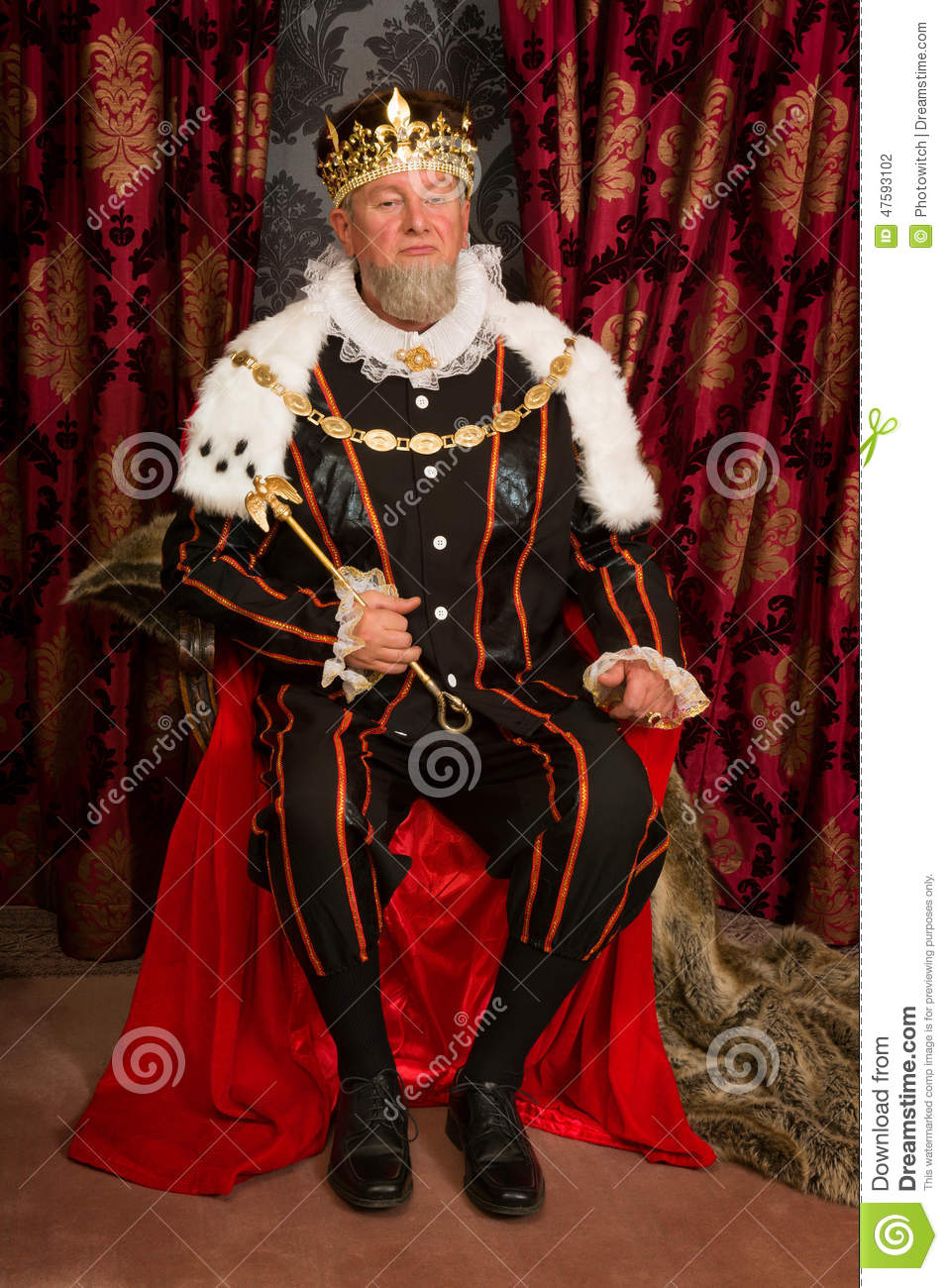 King in tudor costume sitting on his throne holding his scepter.