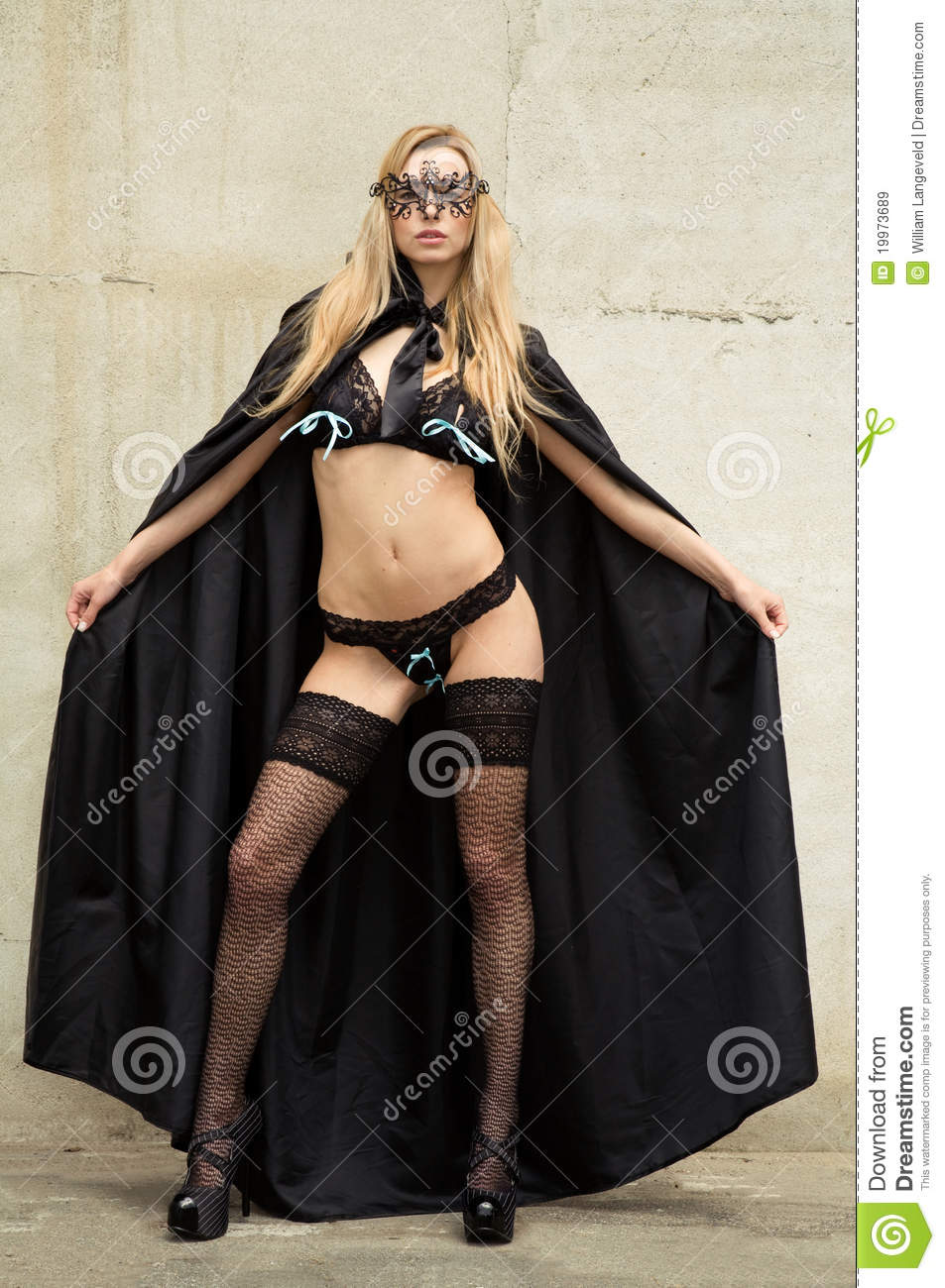 Kinky Beauty In Lingerie With Gotic Cape And Mask Stock
