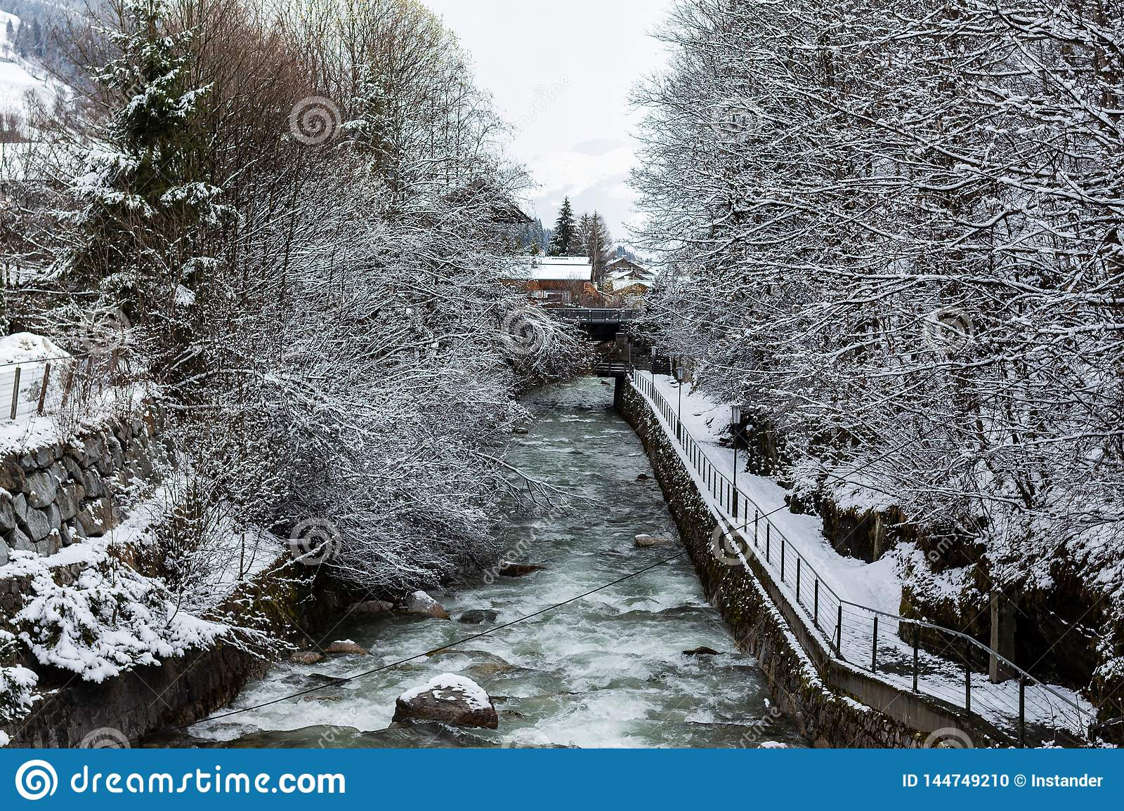 Kirchberg in Tirol, Tirol/Austria - March 26 2019: River flowing through the village and its winter landscape