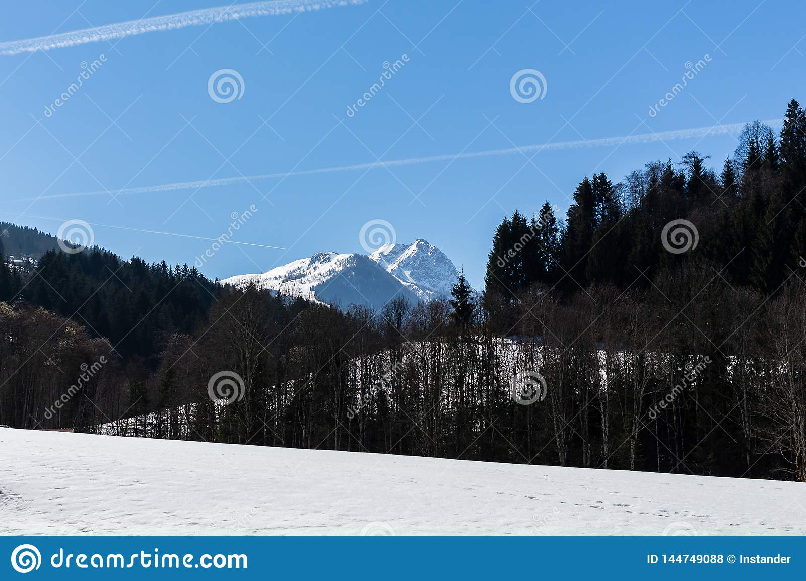 Kirchberg in Tirol, Tirol/Austria - March 24 2019: View on a distant mountain top in the Austrian Alps