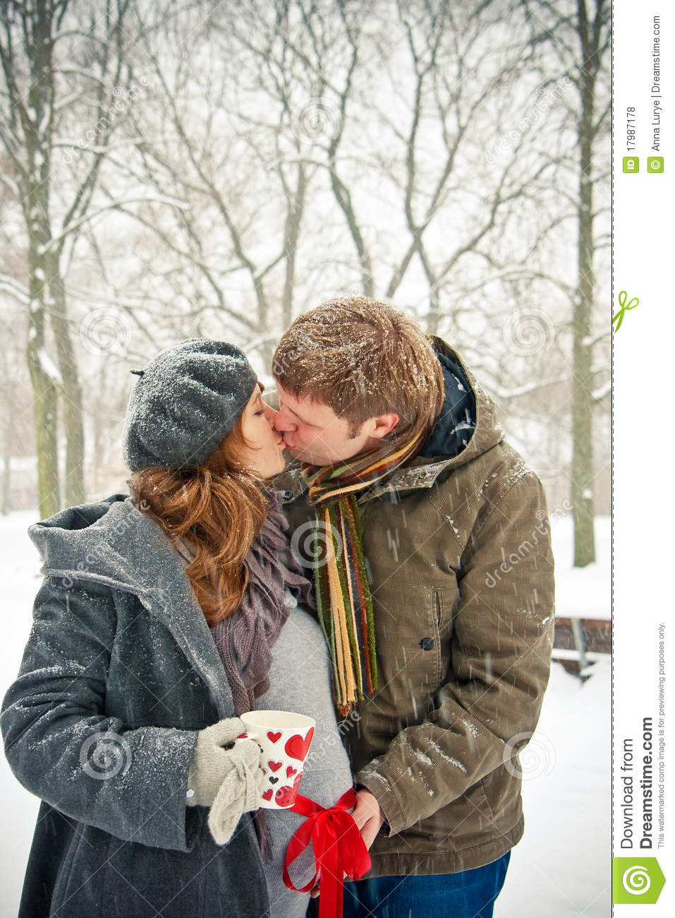 Kissing Couple While Snowing