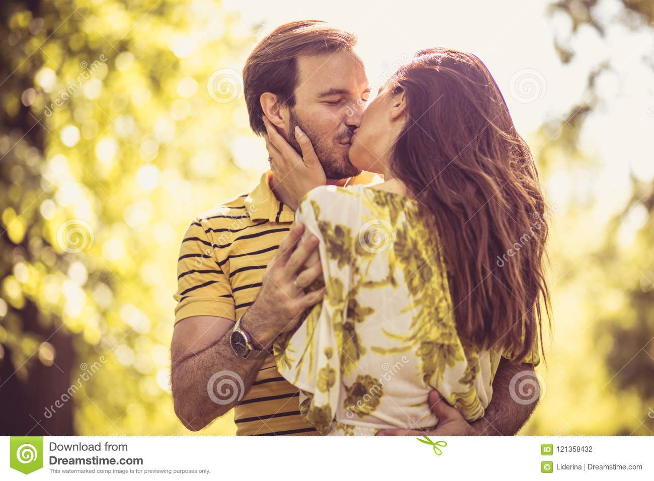 Kissing couple at spring season. Portrait.