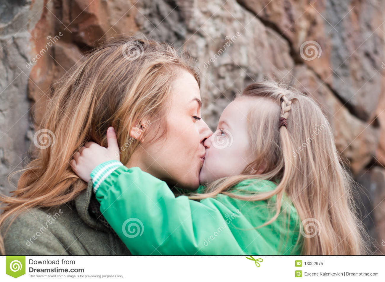 Mom and daughter kissing