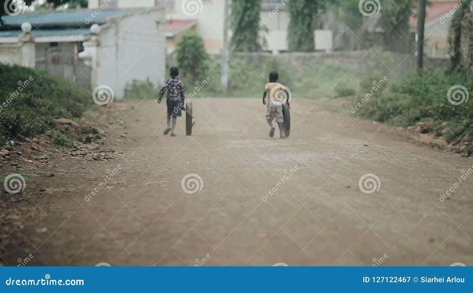 Kisumu Kenya May 17 2018 Back View Of Two African Boys Running