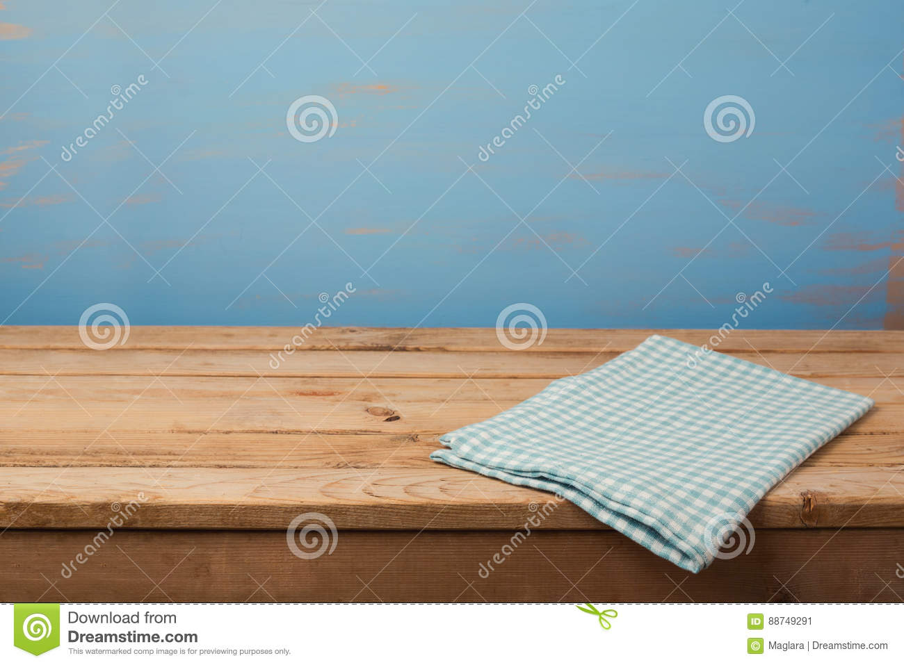 Blue tablecloth background - Kitchen Background With Tablecloth On Empty Wooden Table Over Painted Blue Wall Stock Photo