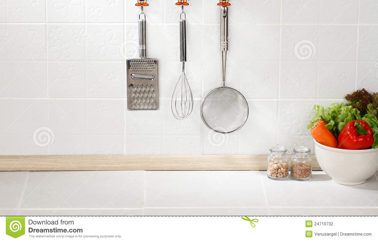Kitchen Background With Cooking Utensil On Hook Against The Wall