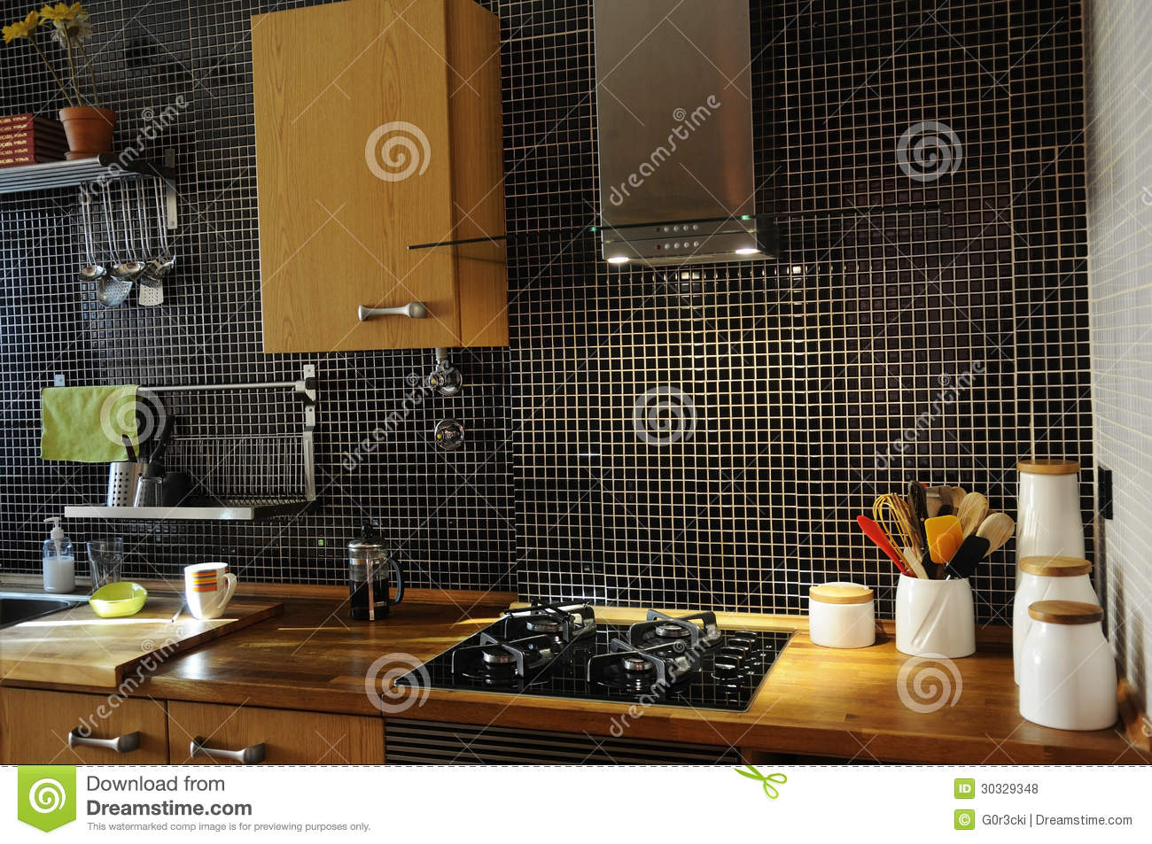 Kitchen with black tiles and natural wood counter royalty free stock
