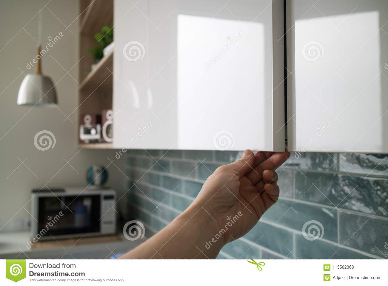 Kitchen Cabinet With Doors Without Handles The Man S Hand Shows How