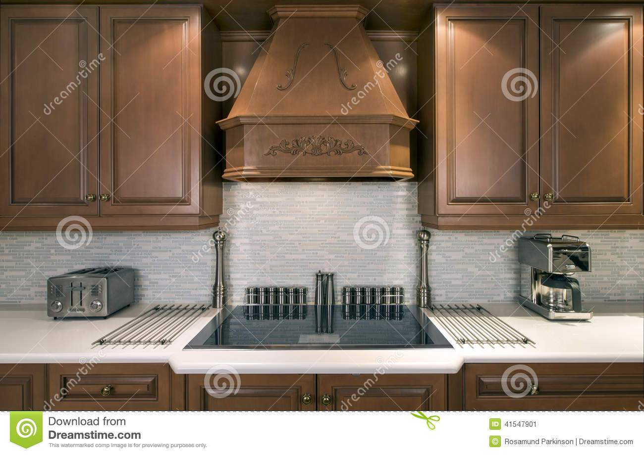 How To Apply Backsplash In Kitchen Kitchen Cabinets And Cooktop Stock Image Image Of Tile