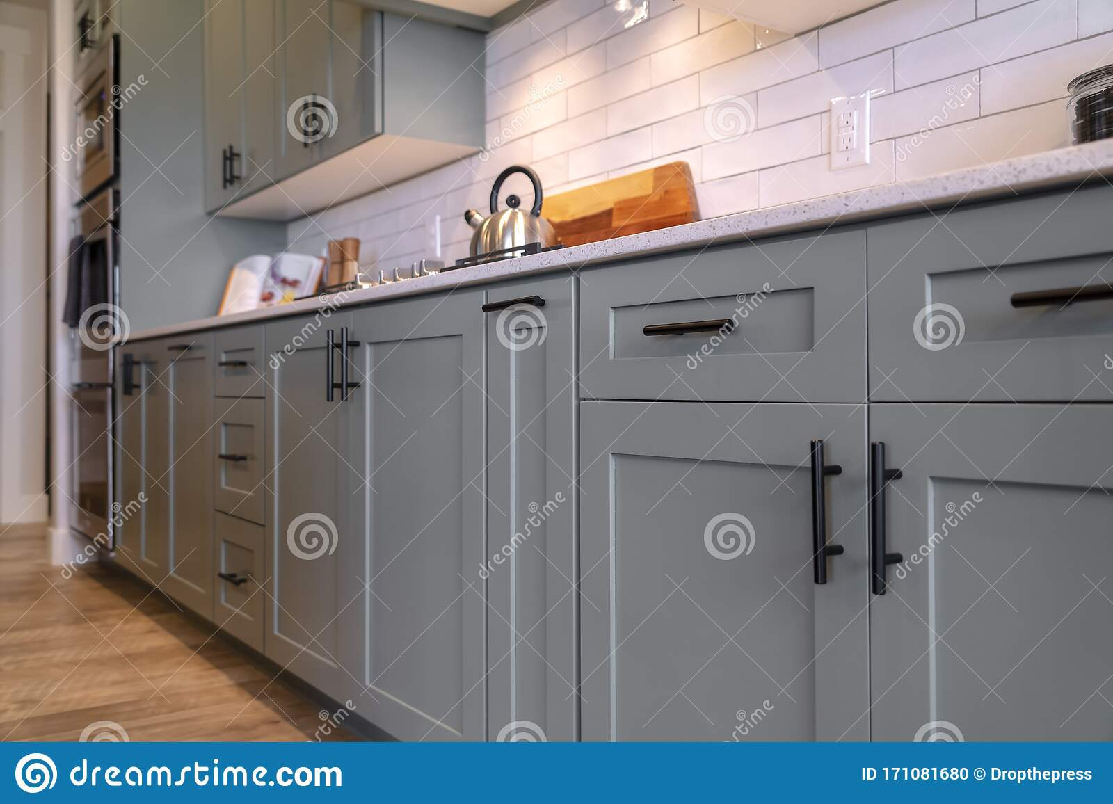 - Kitchen Cabinets With White Countertop Black Handles And Tile