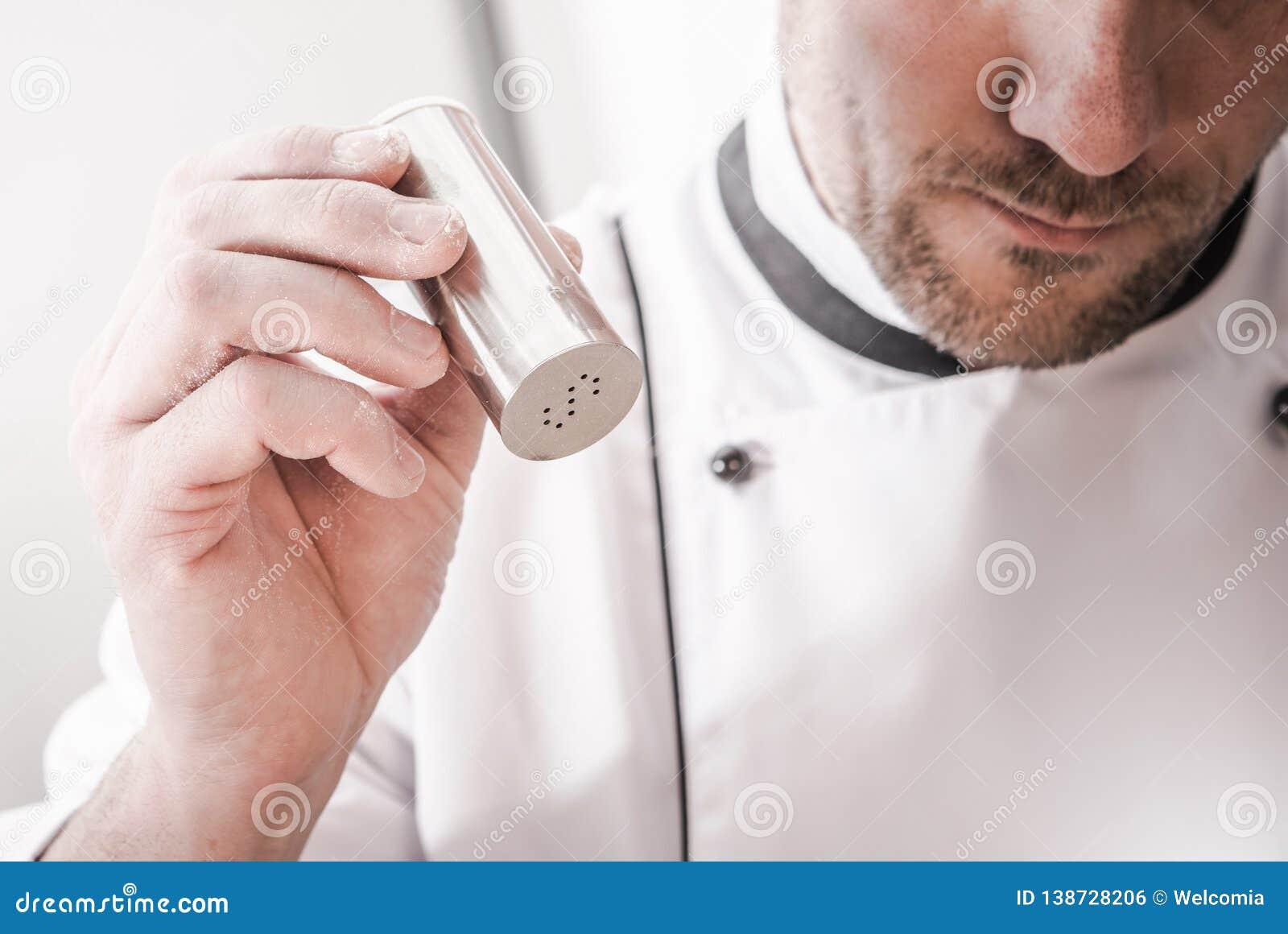 Kitchen Chef Using Salt