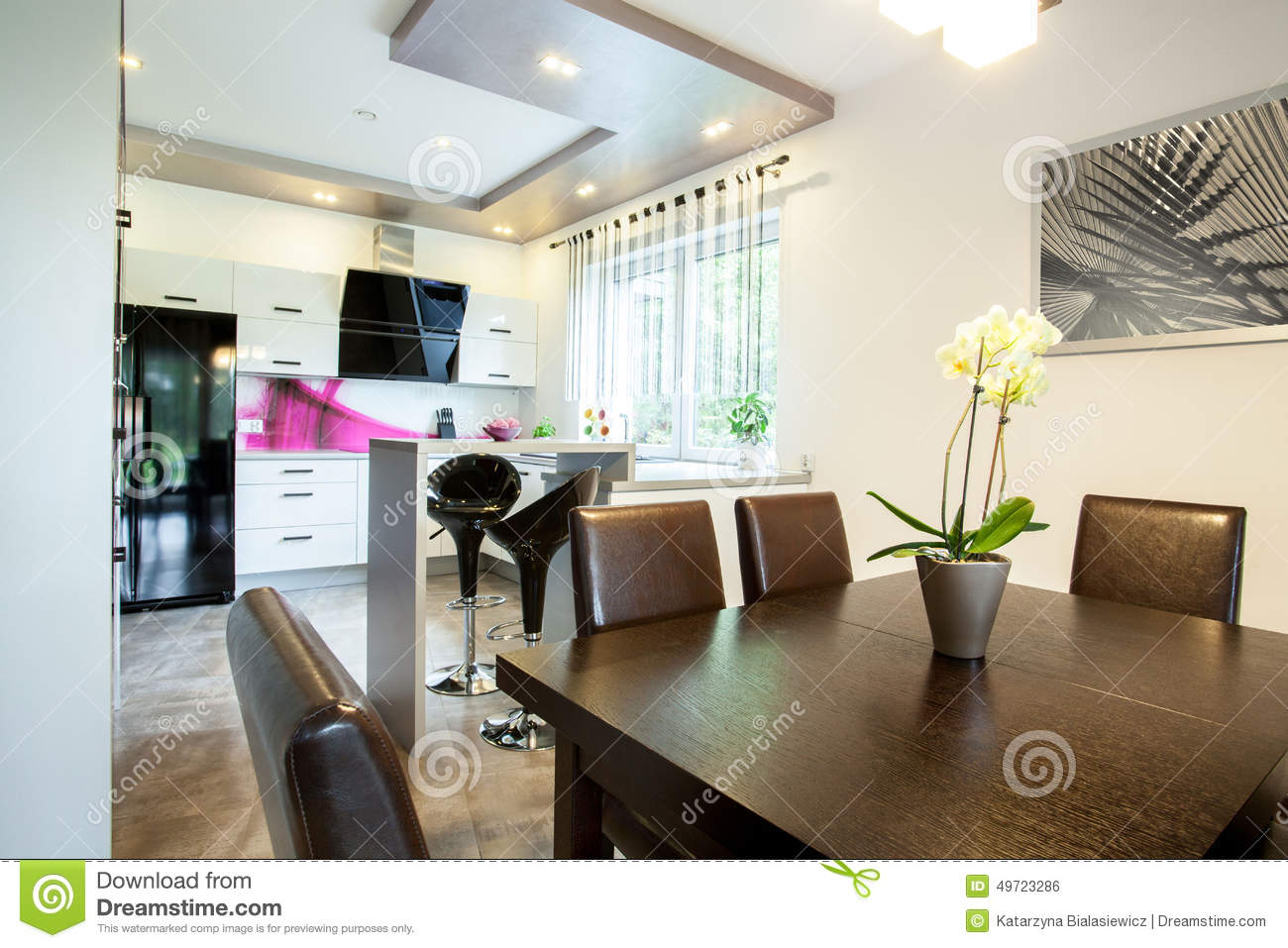 Kitchen connected with dining hall stock photo image for House dining hall design
