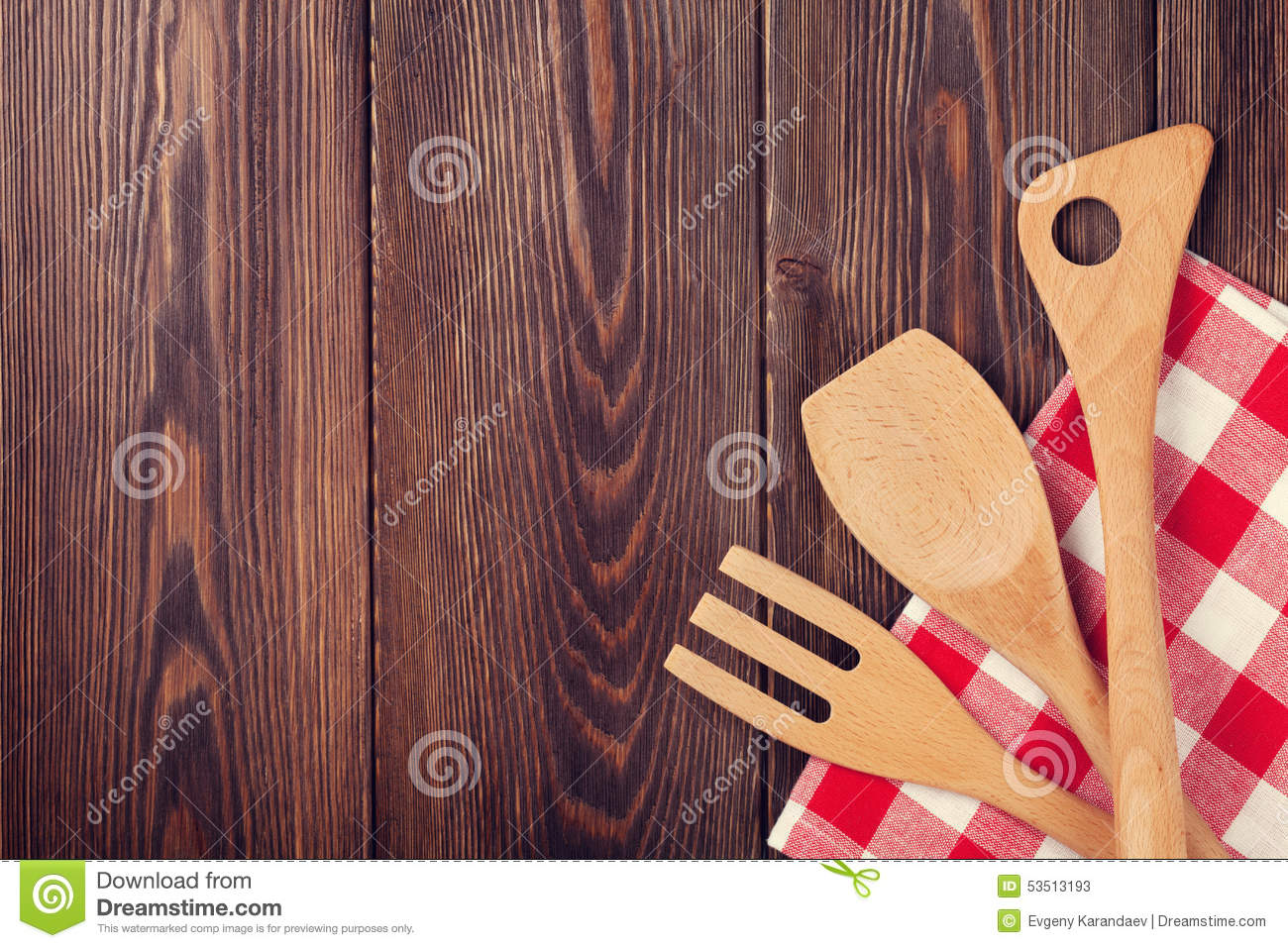 Kitchen cooking utensils over wooden table stock image for Table utensils
