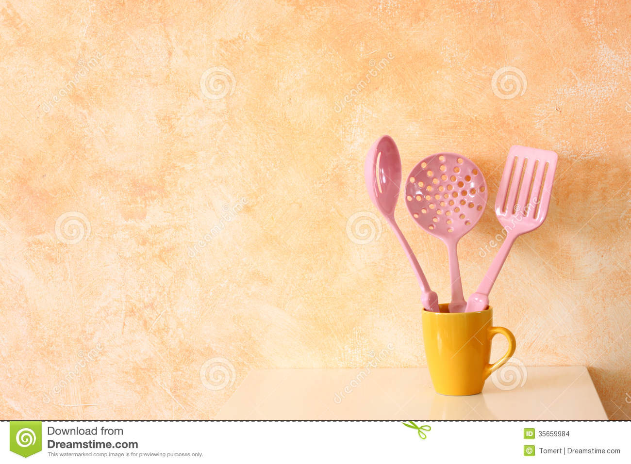 Kitchen Cooking Utensils. Plastic Spatulas In Yellow Cup Against ...
