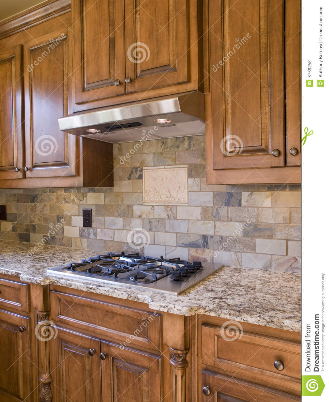 Kitchen Cooktop And Cabinets Angle View Stock Photo