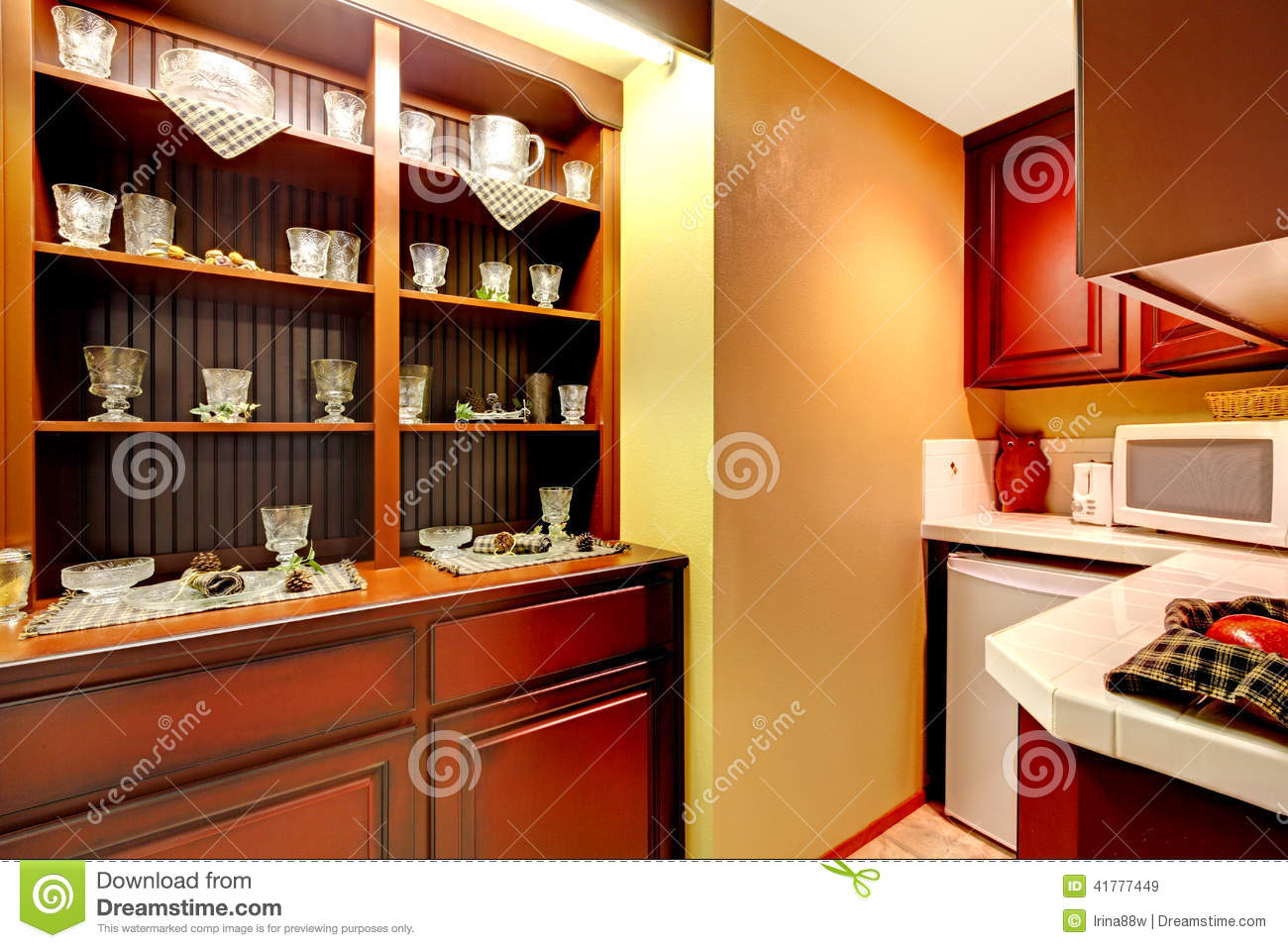 Kitchen cabinets with white appliances and old storage cabinet