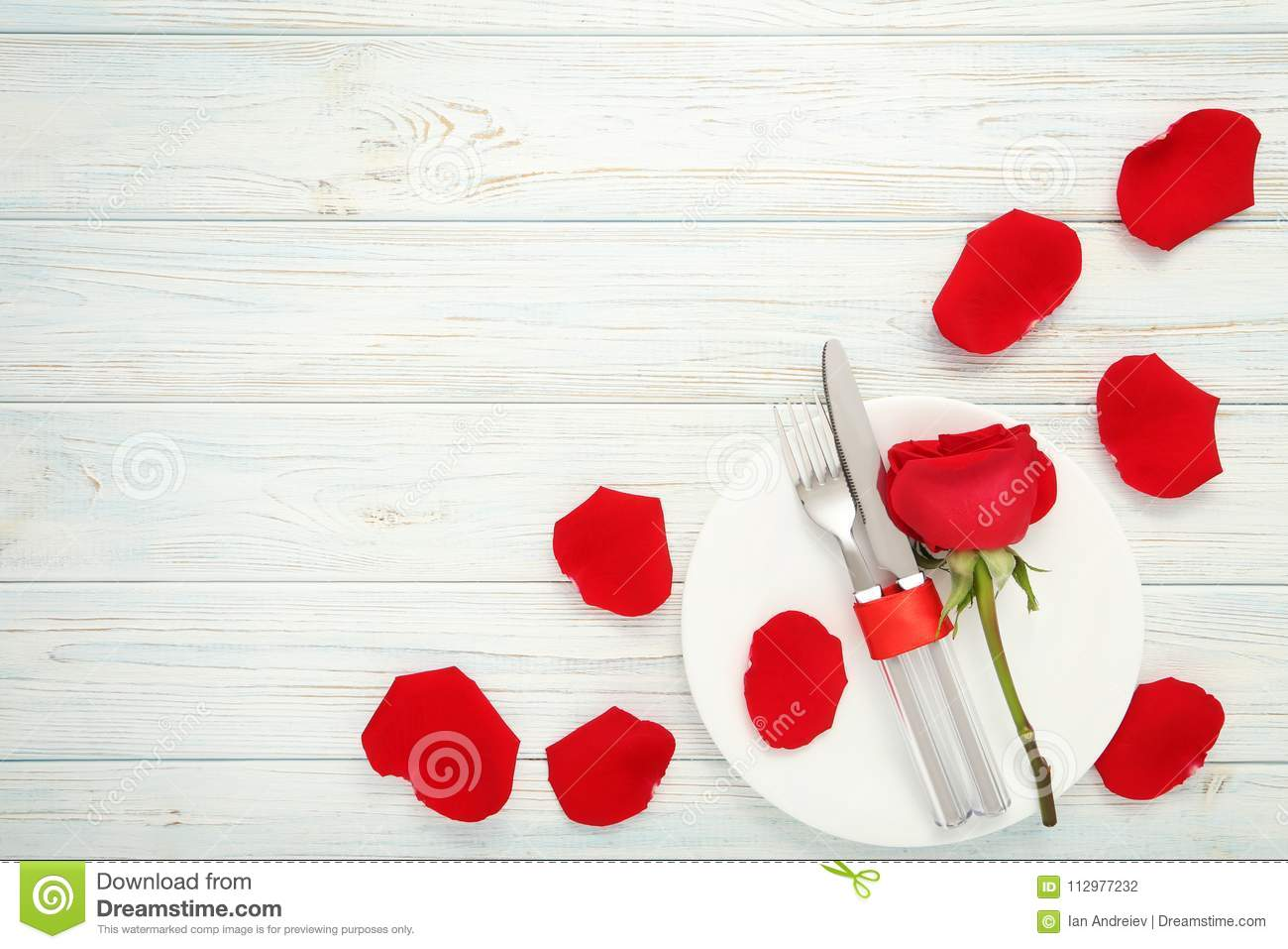Kitchen cutlery with red rose