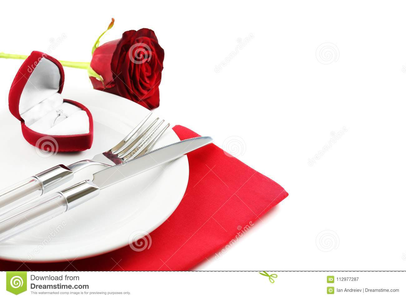 Kitchen cutlery with ring and red rose