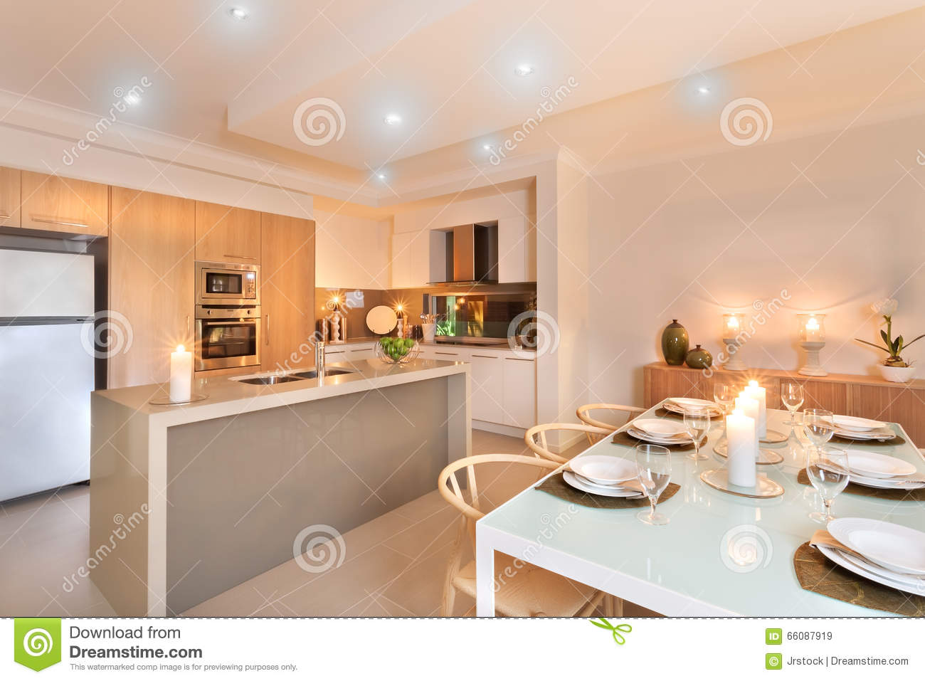 Kitchen And Dinner Table Setup With Candles Flashing
