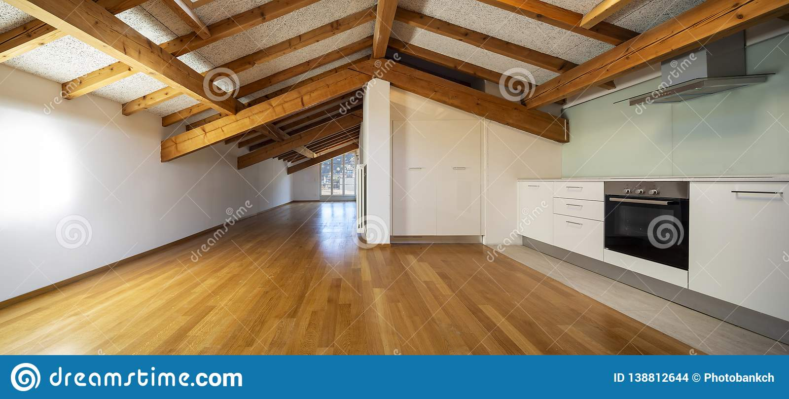 Kitchen in empty apartment with wooden beams