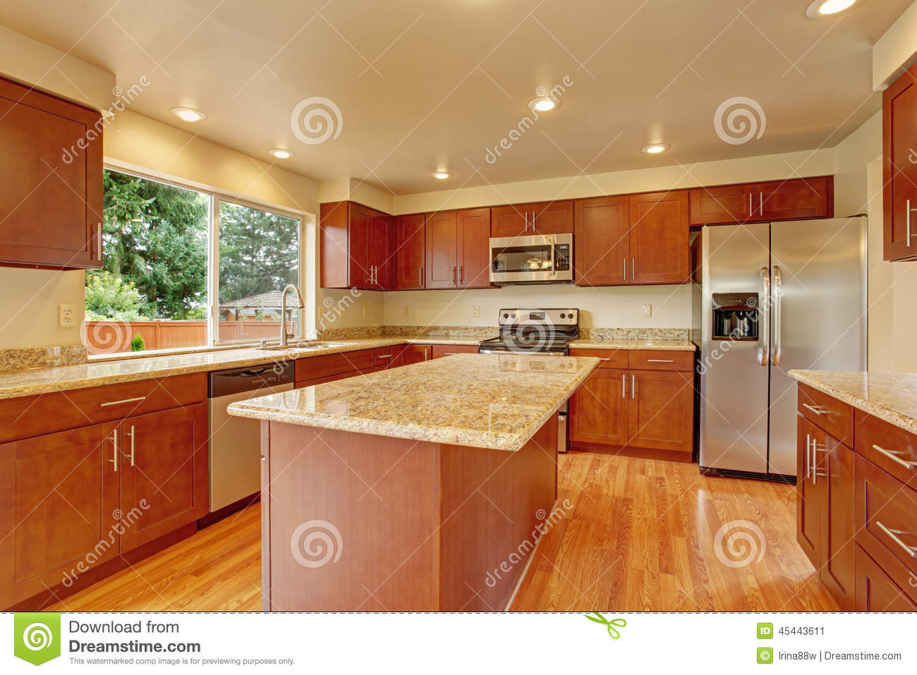 Kitchen furniture with island in empty house stock image for Mobilia kitchen