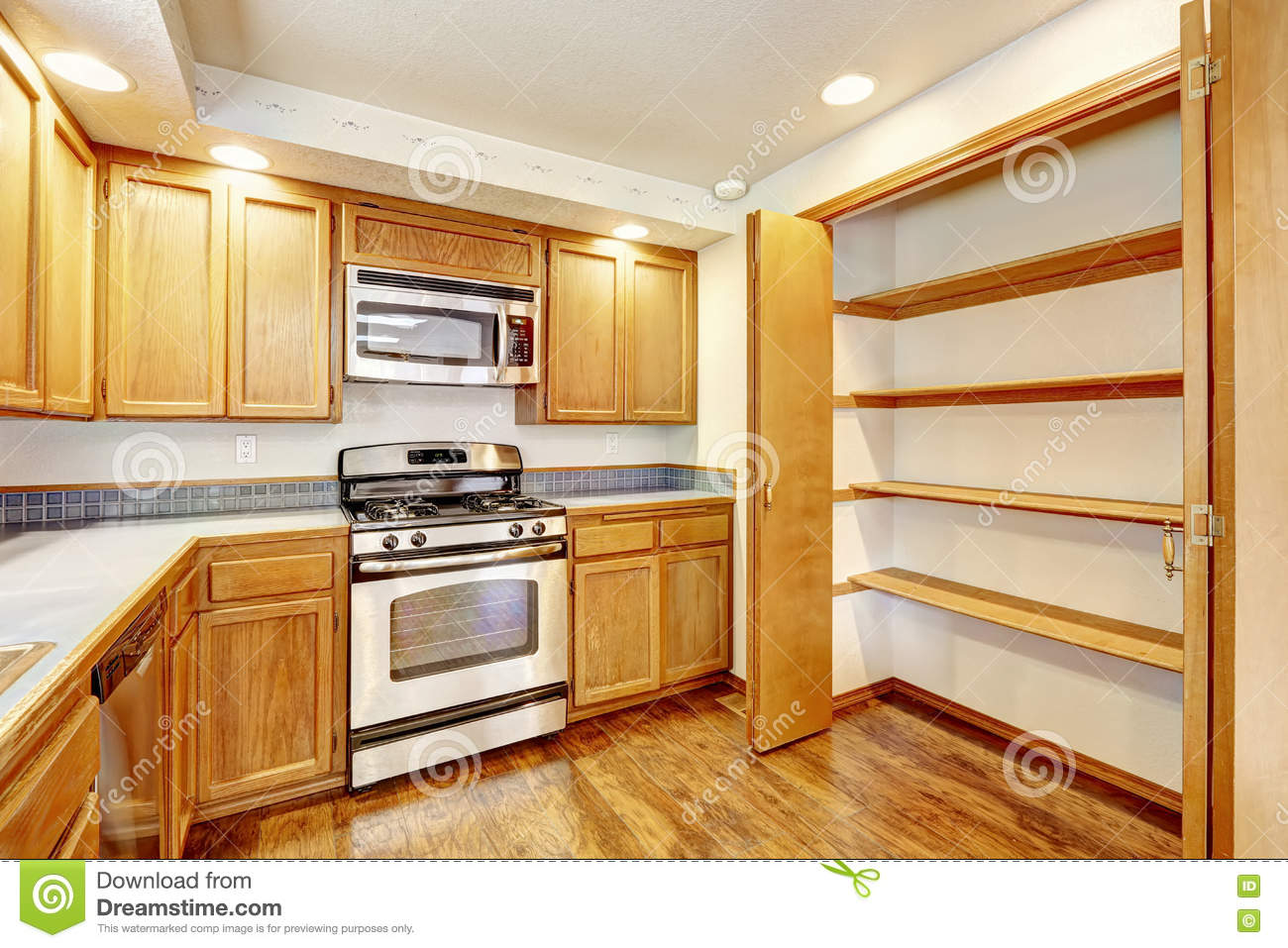 Kitchen with golden wood cabinets and hardwood floor for Kitchen cabinets usa