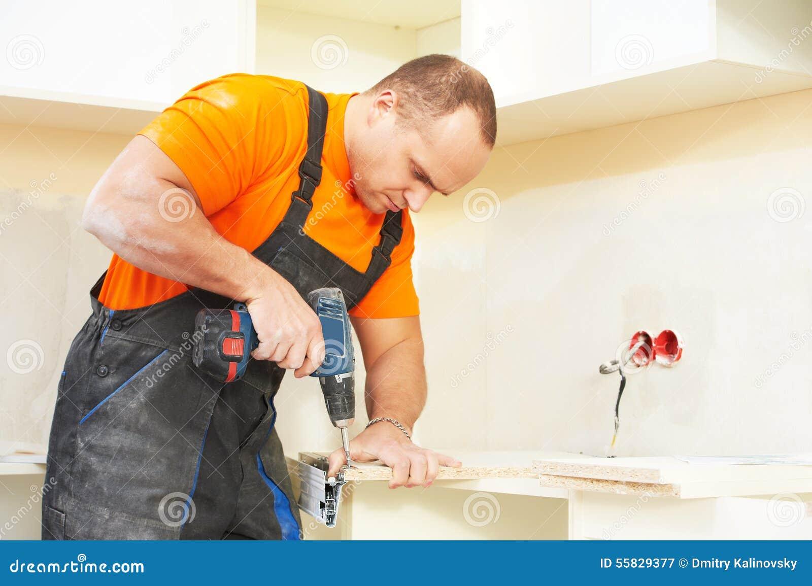 Kitchen Installer At Carpenter Work Stock Image - Image of cabinet ...