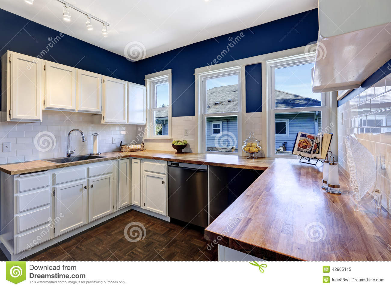 Kitchen interior in bright navy and white colors stock for Kitchen walls with white cabinets