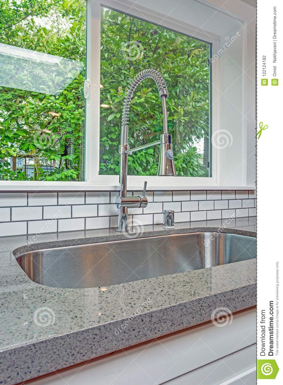 Kitchen interior with focus on undermount sink.