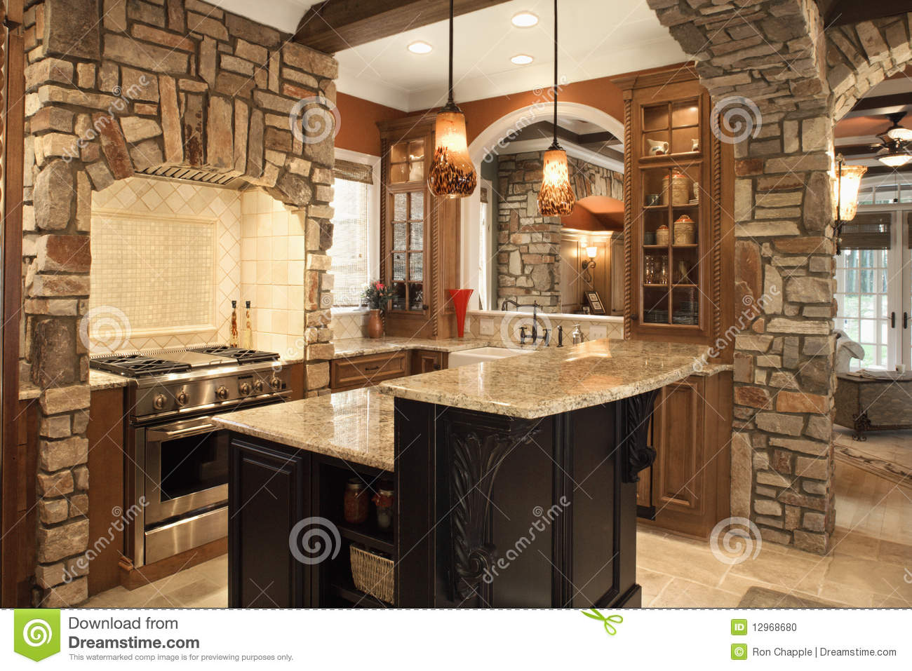 Kitchen interior with stone accents in affluent ho stock for Cuisine equipee avec bar