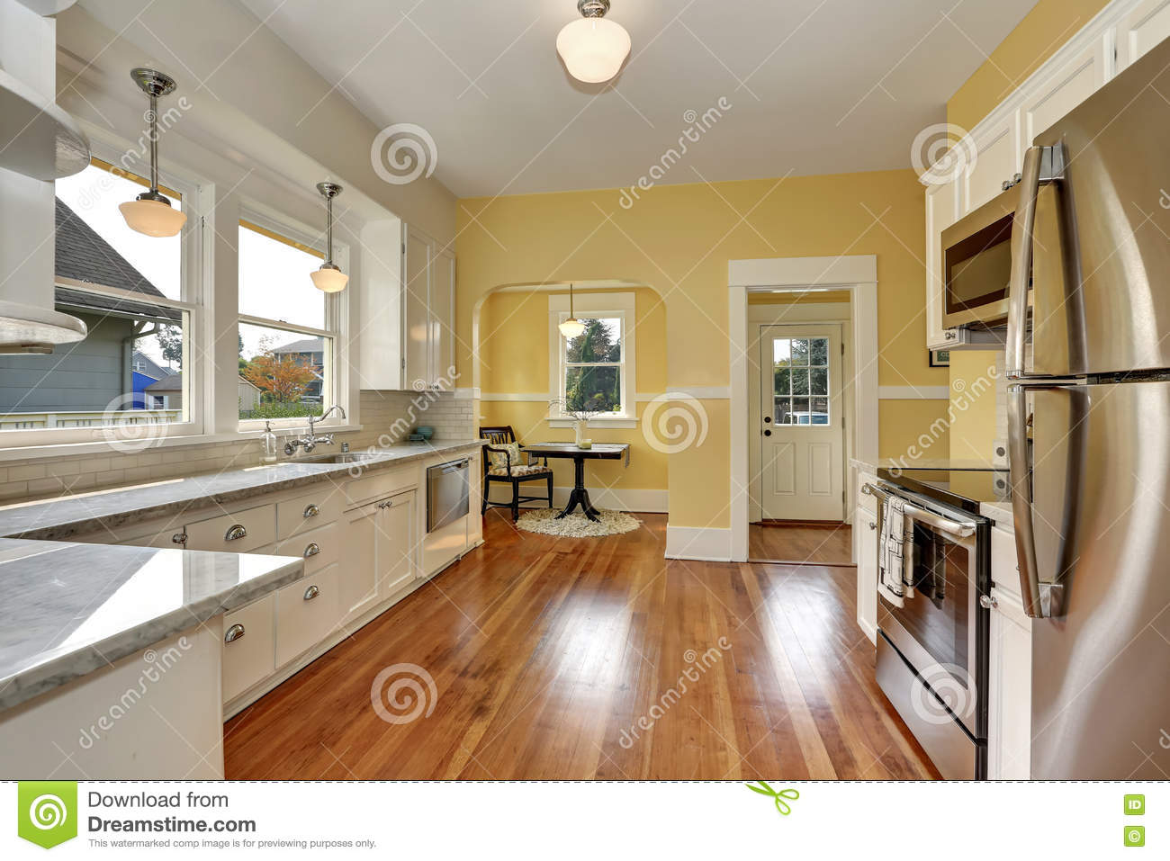 Kitchen Interior With White Cabinets Yellow Walls And